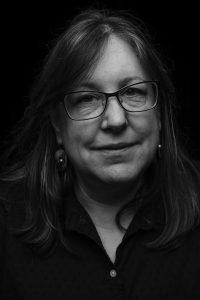 AuthorPhoto of Laura LeHew headshot (by Dean Davis)